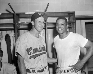 Willie Mays and Stan Musial Standing in Locker Room